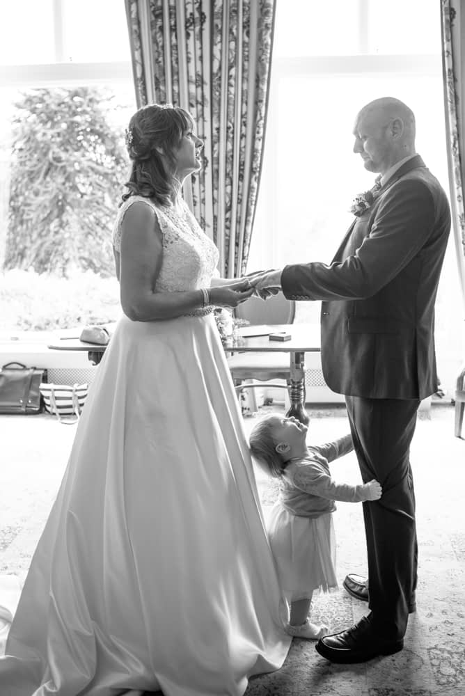 Cheeky Winnie looking up during ceremony, Merewood Country Hotel Hotel weddings, Lake District
