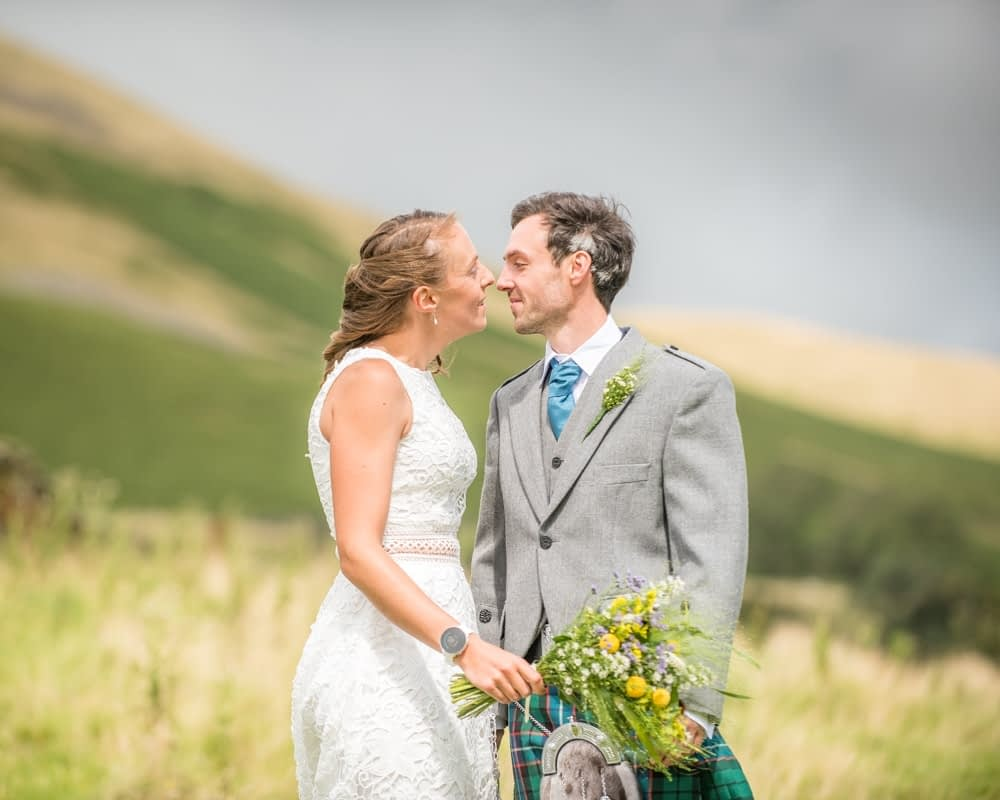 Kisses, Howgills wedding, Sedbergh, Lake District wedding photographers
