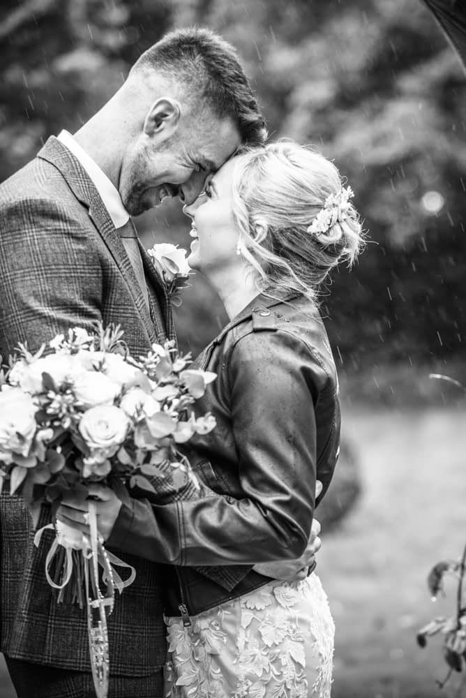 laughing outside in the rain,  wedding photographers Carlisle register office elopement wedding Lake District