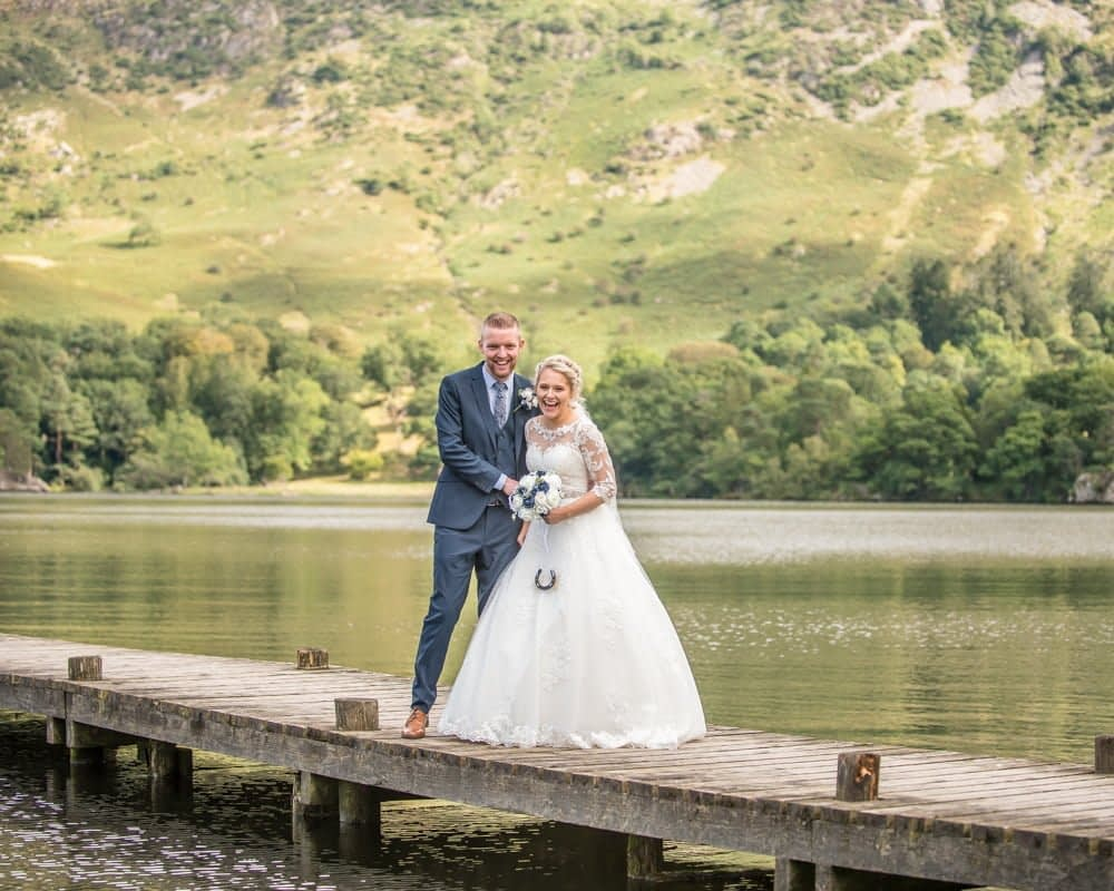 Bride and groom on jetty on Ullswater, Inn on the Lake Weddings, Lake District