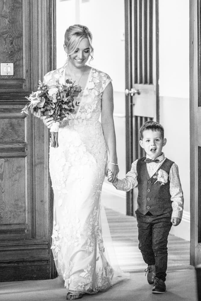 Milo walking Mum down the aisle,  wedding photographers Carlisle register office elopement wedding Lake District