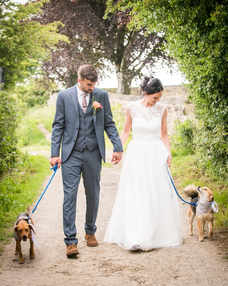 Bride and groom walking dogs, Sheffield wedding photographers