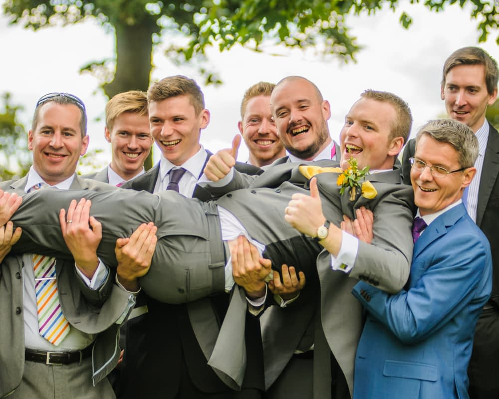 Groom getting picked up by groomsmen, Sheffield wedding photographers, Smallshaw Farm Cottages