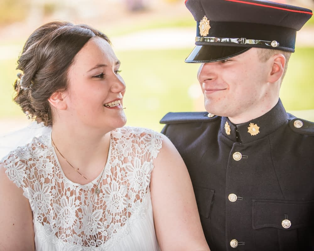 Bride and groom looking at each other during register signing, Gretna Green weddings