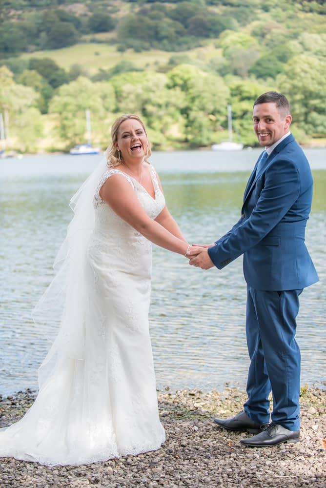 Laughing by the lake, Lakeside Hotel, Windermere wedding photographers