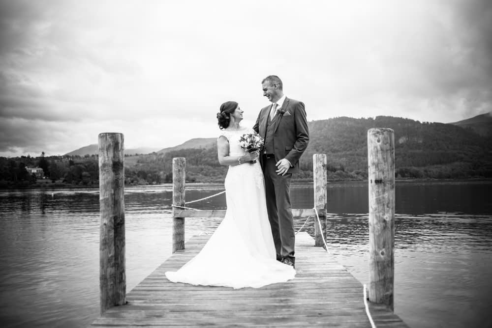 Laughing on the jetty on Derwent, Lingholm wedding, Lake District