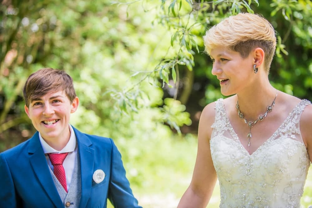 Laughing together, Carlisle Register office, Lake District wedding photography