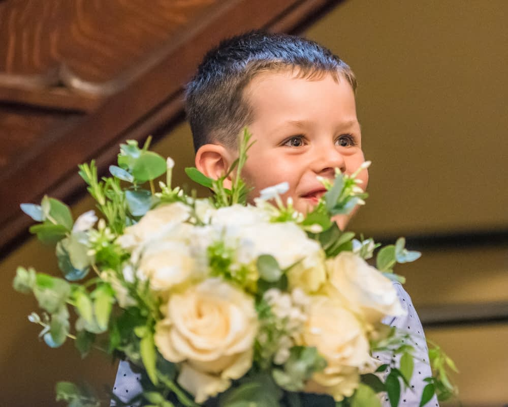 Milo and the wedding bouquet,  wedding photographers Carlisle register office elopement wedding Lake District