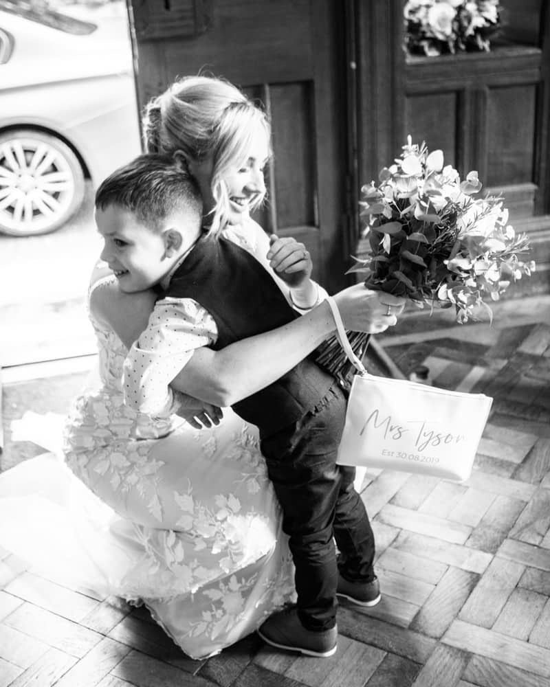 pageboy hugging mum, Lady Gilfords House, Carlisle regsiter office, Lake District wedding photography