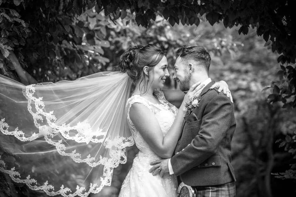 Posing by the leaves in the gardens, Sheffield wedding photographers, Ringwood Hall Hotel