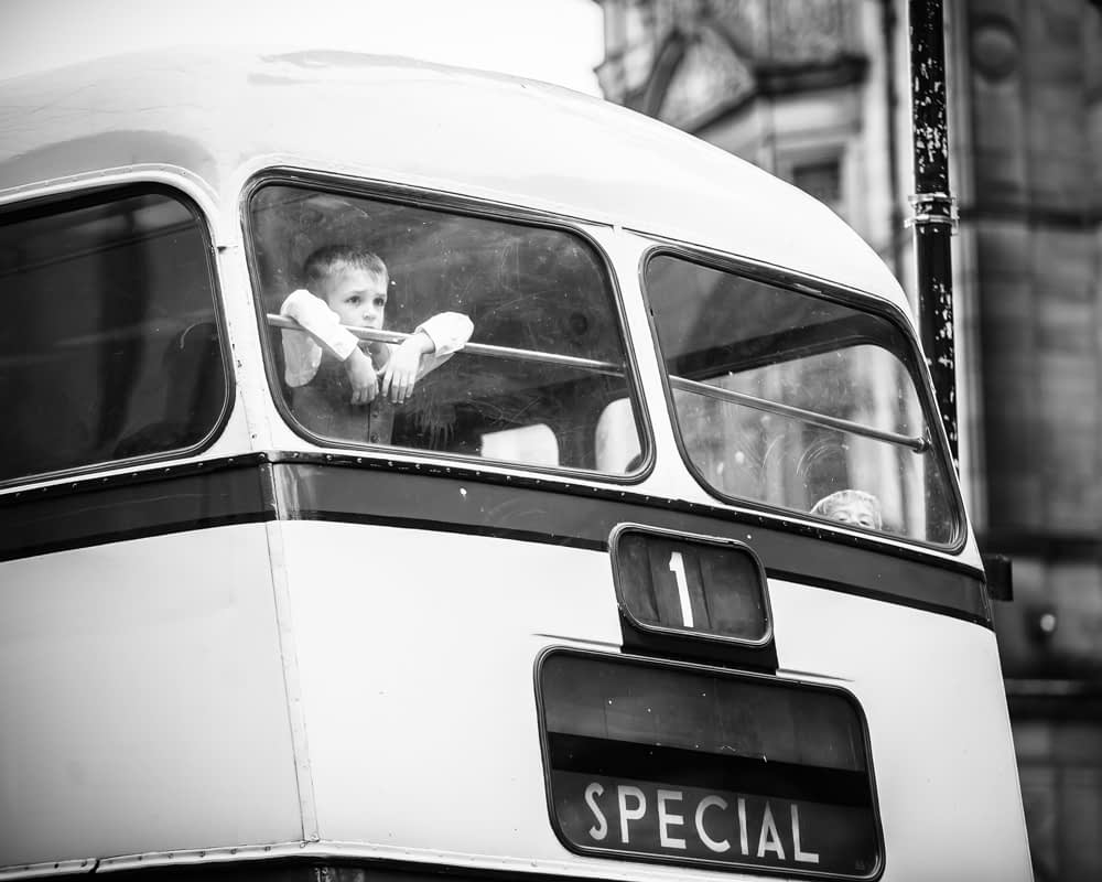 pageboy looking out of bus, Peace Gardens wedding poses, Sheffield wedding photographer