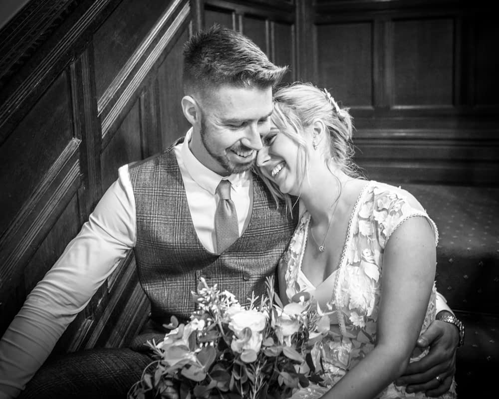 Bride and groom snuggles,  wedding photographers Carlisle register office elopement wedding Lake District