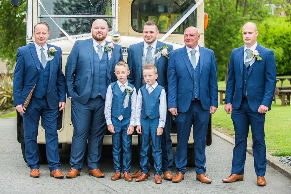 Groomsmen posing outside vintage bus, Sheffield wedding