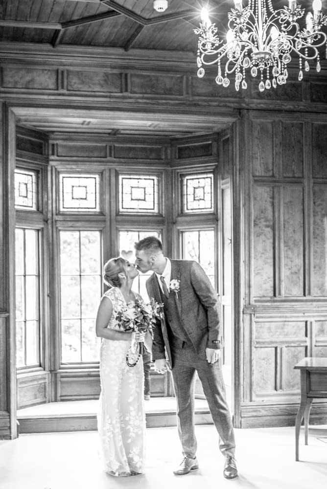 Kisses after wedding ceremony,  wedding photographers Carlisle register office elopement wedding Lake District