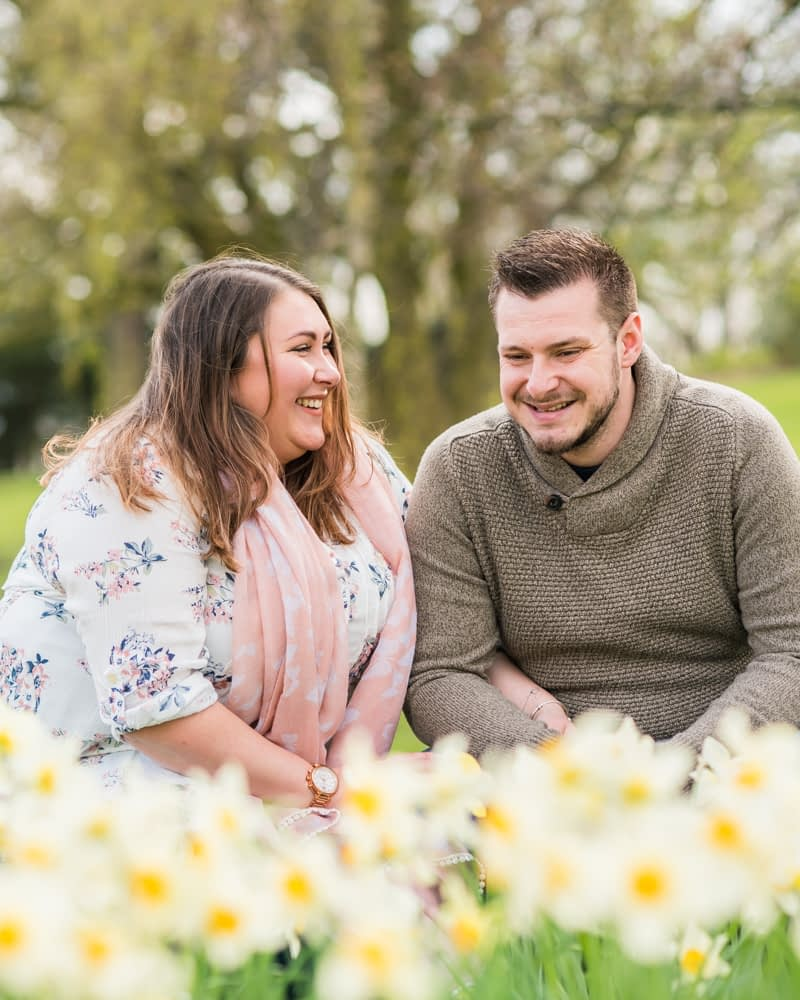 Alex & Ben laughing in daffodils, Sheffield wedding photographers