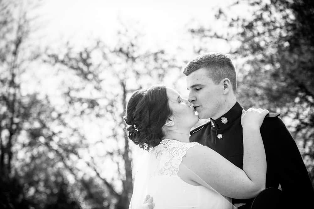 Kisses in water gardens, Greens at Gretna wedding photographer