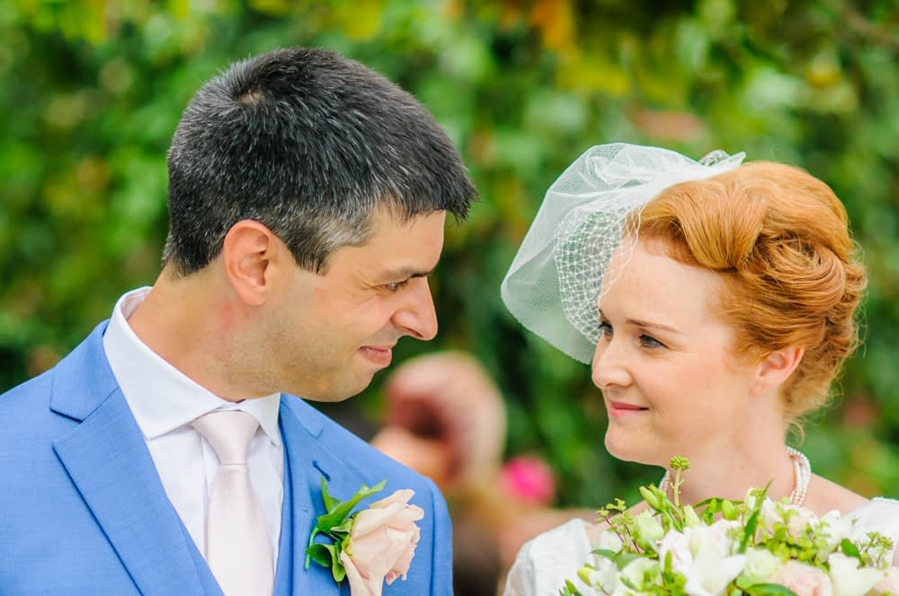 Bride and groom looking at each other at top of aisle, Yorkshire weddings