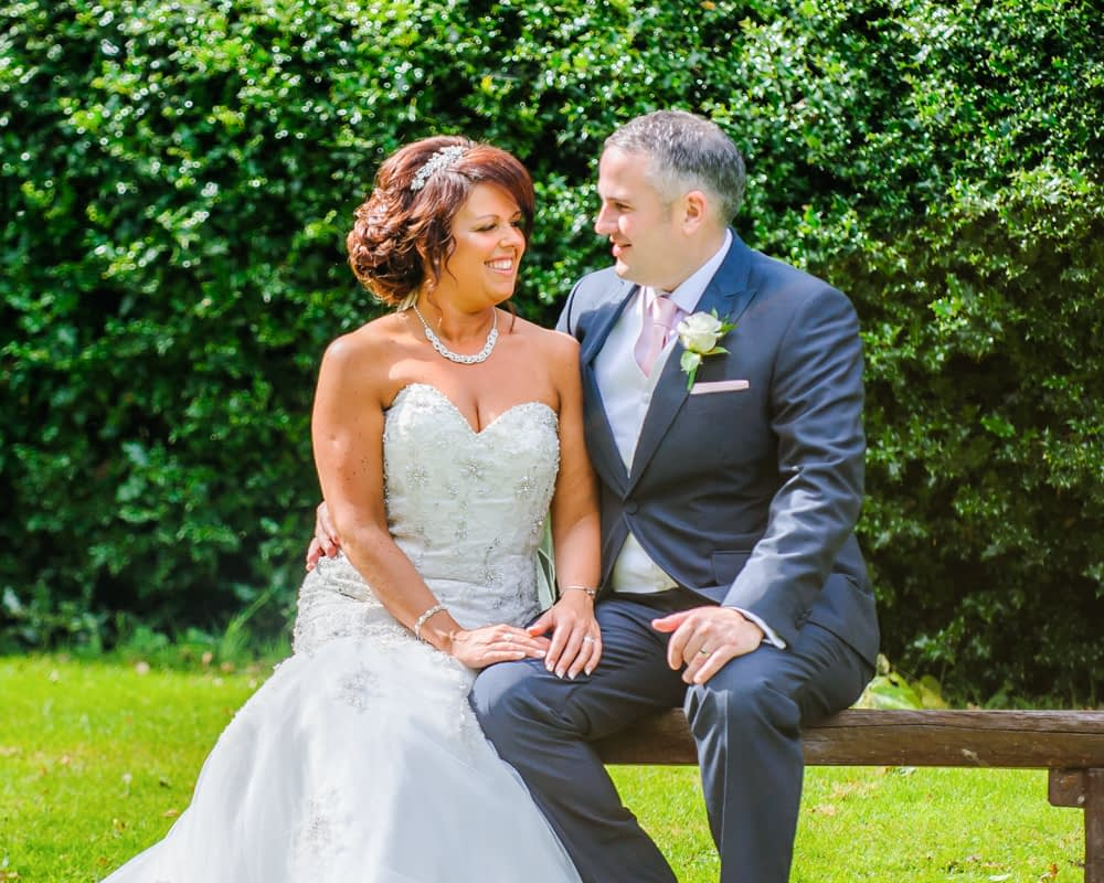 Chatting on a bench, Whitley Hall weddings, Sheffield wedding photographers