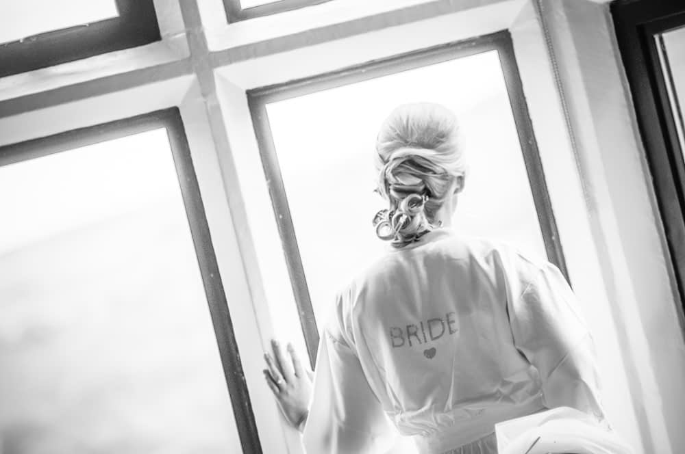 Bride looking out of window, Maynard wedding photography Sheffield