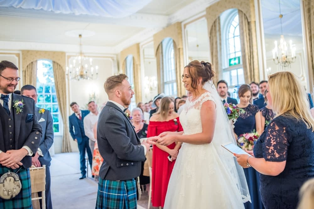 Exchanging rings in wedding ceremony, Sheffield wedding photographers, Ringwood Hall Hotel