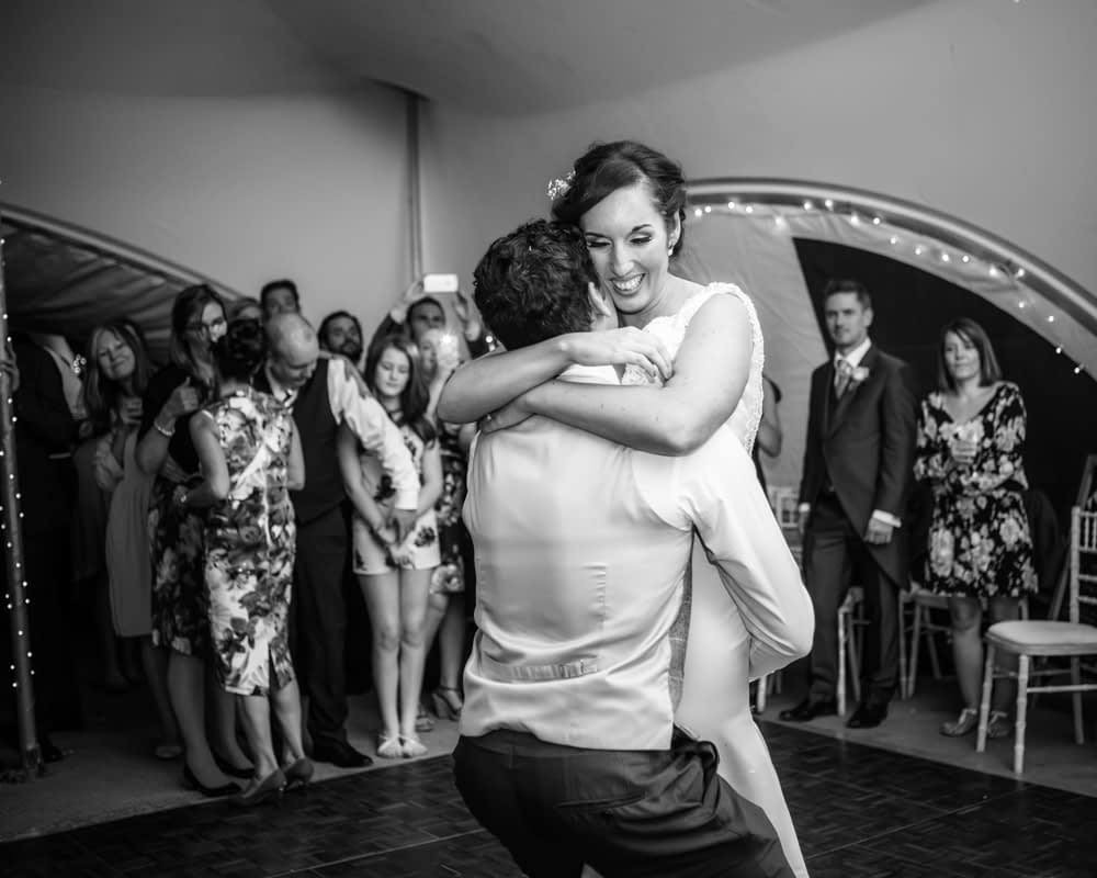 Lifting up bride, Sheffield wedding photographers