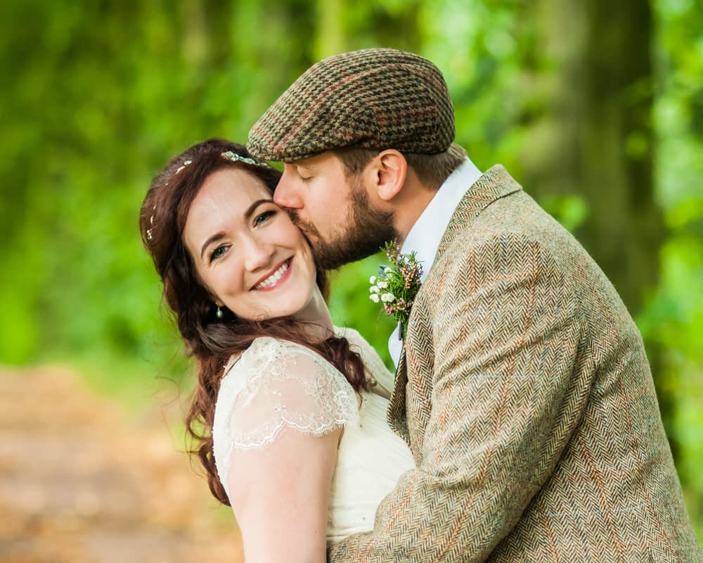 Kisses on cheek,  Wentworth Castle Garden wedding, Sheffield photographers