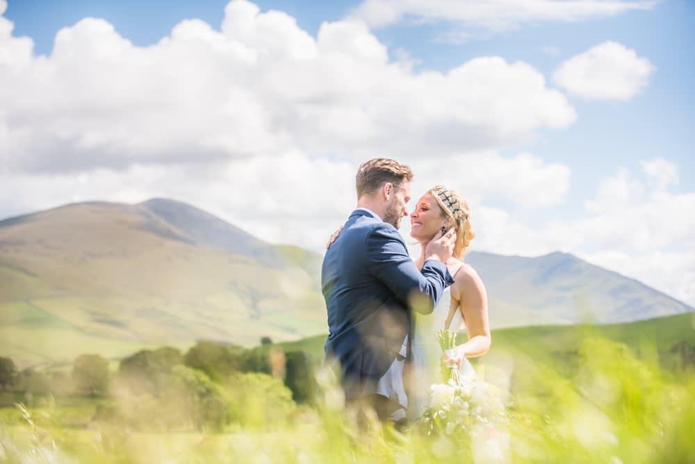Tender moments in fields nearby, Overwater Hall wedding, Lake District