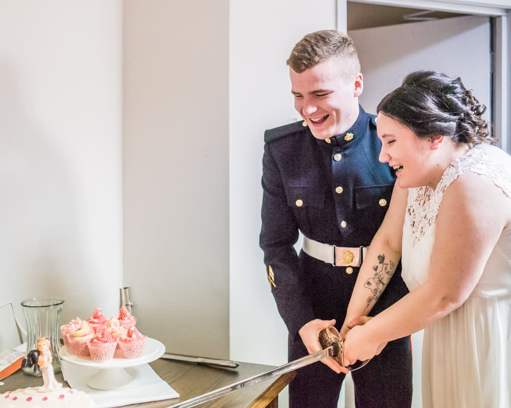Cutting the cake with sword, Greens at Gretna weddings