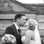Bride and groom kiss with hall in background, Wortley Hall, Sheffield wedding photography