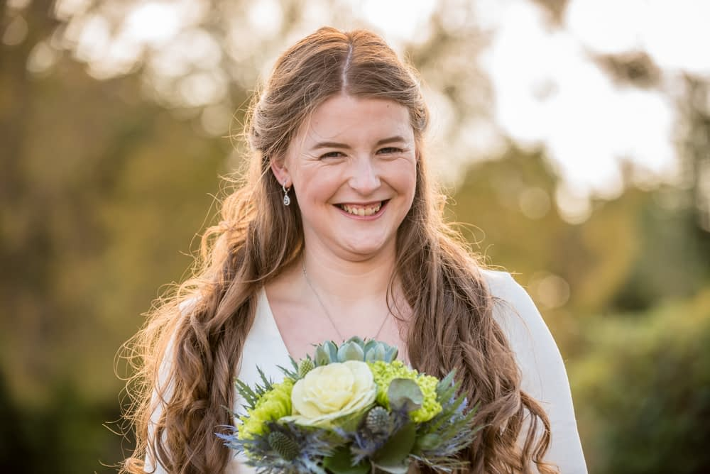 Bride and bouquet with Autumn light, Howgills Farm weddings, Sedbergh, Lake District wedding photographers