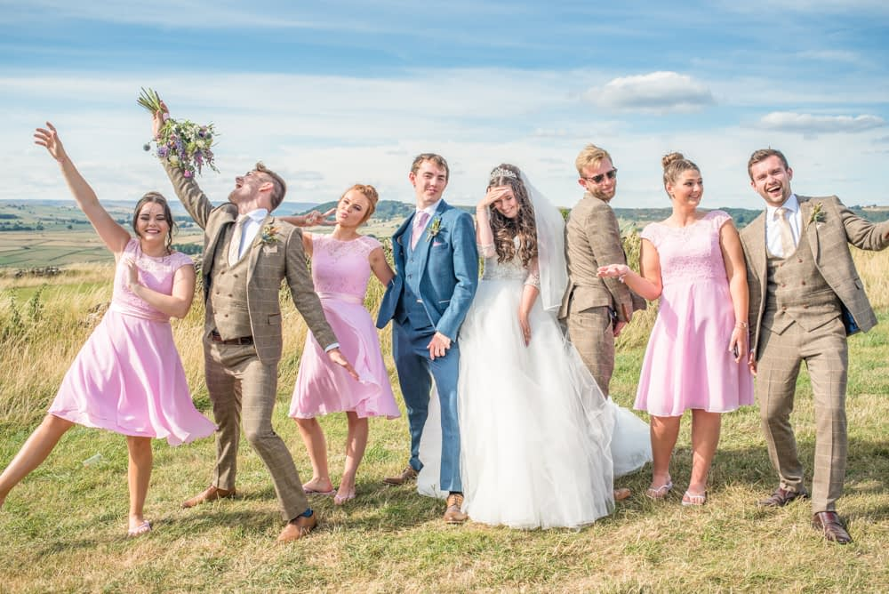 Bridal party fun poses, Peak District countryside wedding