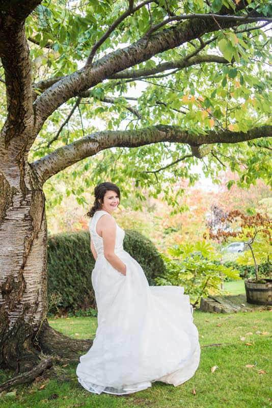 Helen twirling in her wedding dress in Halifax Hall grounds in Sheffield