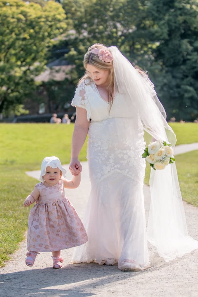 Bride and her daughter walking, Derwentwater Rock the Dress, Lake District wedding photographer