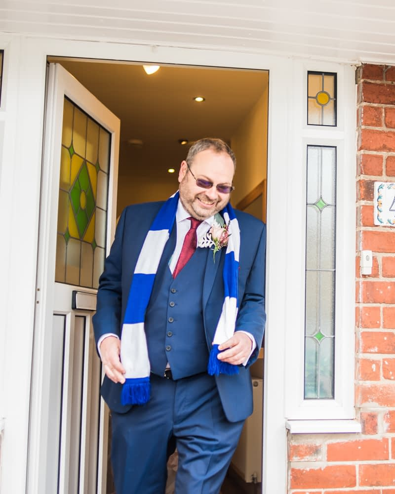 Dad leaving house with football scarf, Maynard wedding, Sheffield photographers