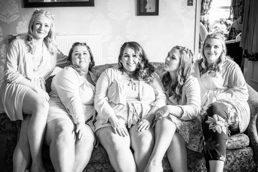 Bride squad together in dressing gowns, Ye Olde Bell weddings
