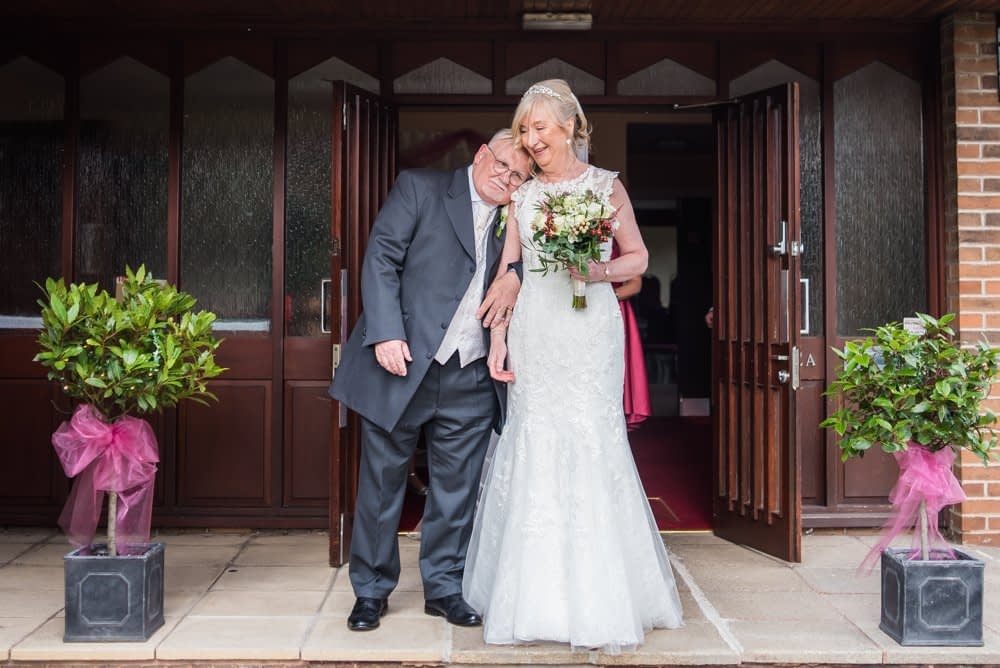 Snuggles for David the groom,  Hotel Van Dyk wedding photography Chesterfield