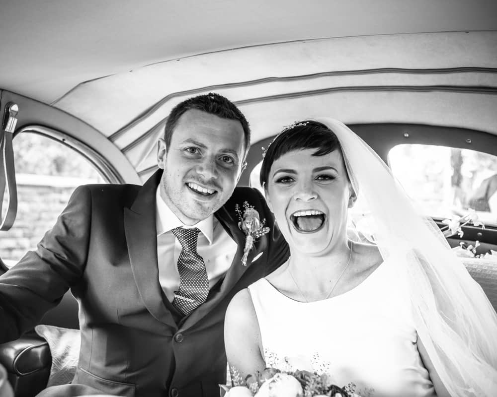 Bride and groom in wedding car, Sheffield wedding photographers