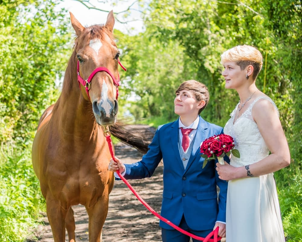 With snowy the racehorse,Carlisle Register office, Lake District wedding photography
