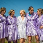 Bride and bridesmaids in dressing gowns laughing in home garden, Wortley Hall, Sheffield wedding photography
