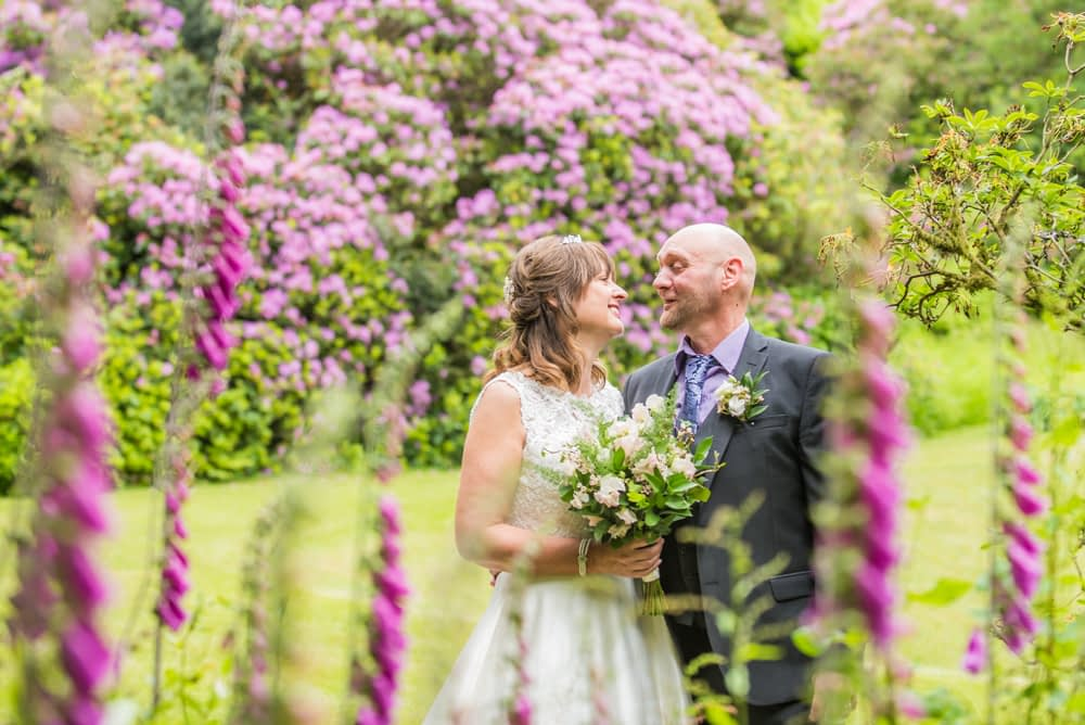 Bride and groom looking at each other, Merewood House, Windermere, Lake District wedding photographers