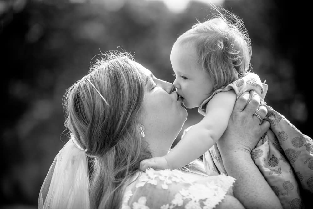 Mama kisses, Derwentwater Rock the Dress, Lake District wedding photographer