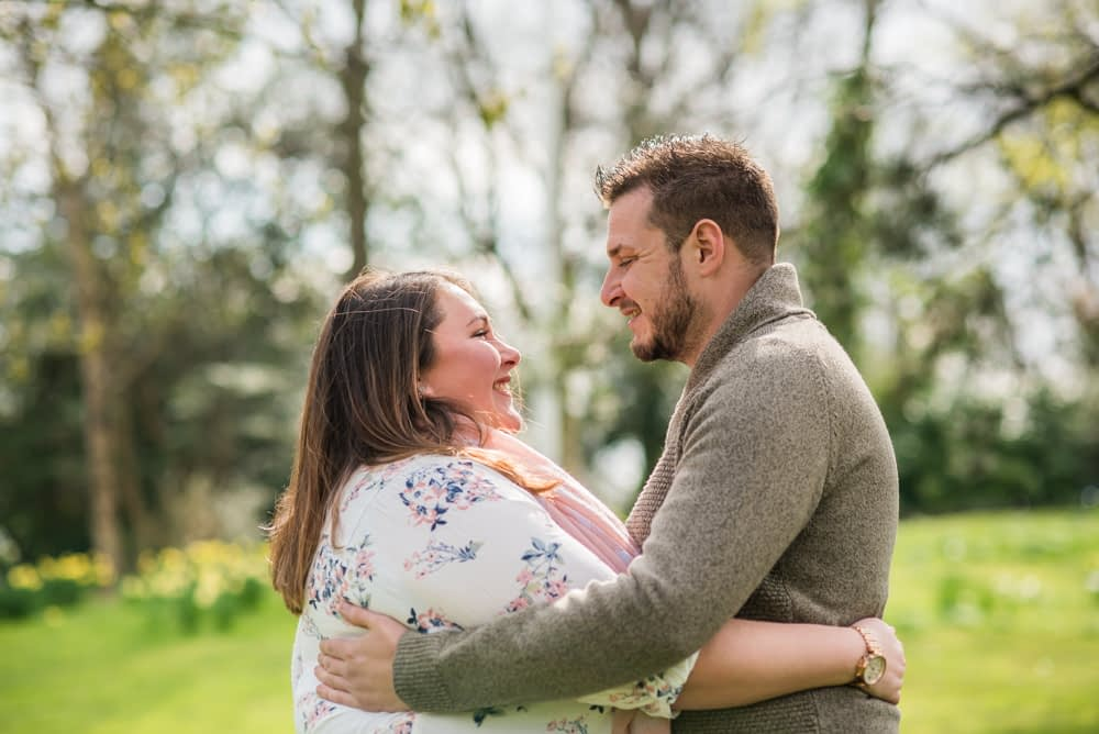 Smiles for each other, Sheffield Botanical Gardens engagement shoot