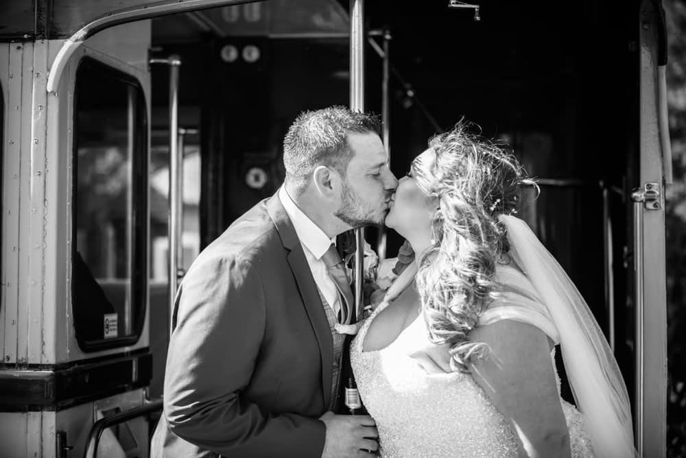 Kissing on vintage bus, Ye Olde Bell wedding, Retford
