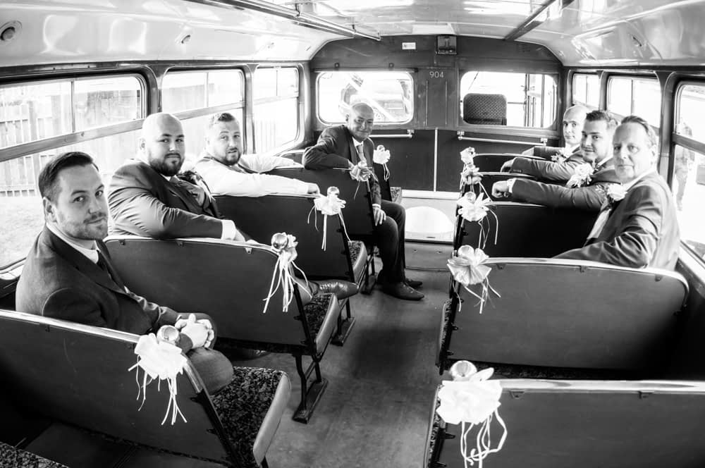 Groomsmen on the vintage bus