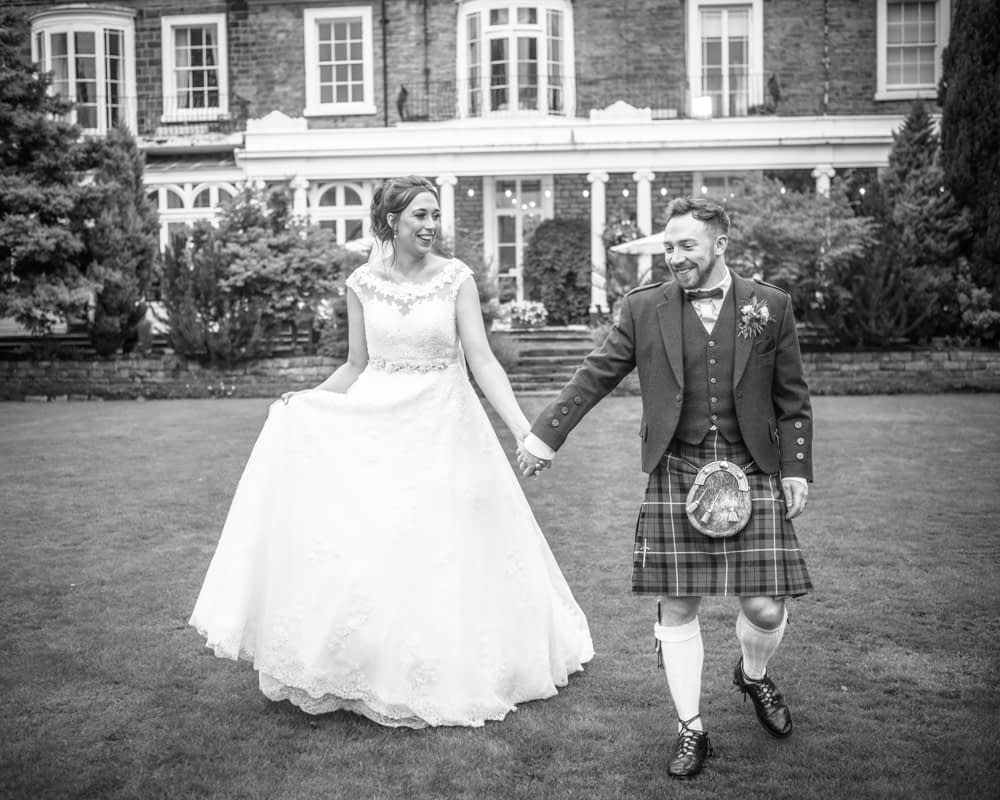 Walking outside by the hotel, Sheffield wedding photographers, Ringwood Hall Hotel