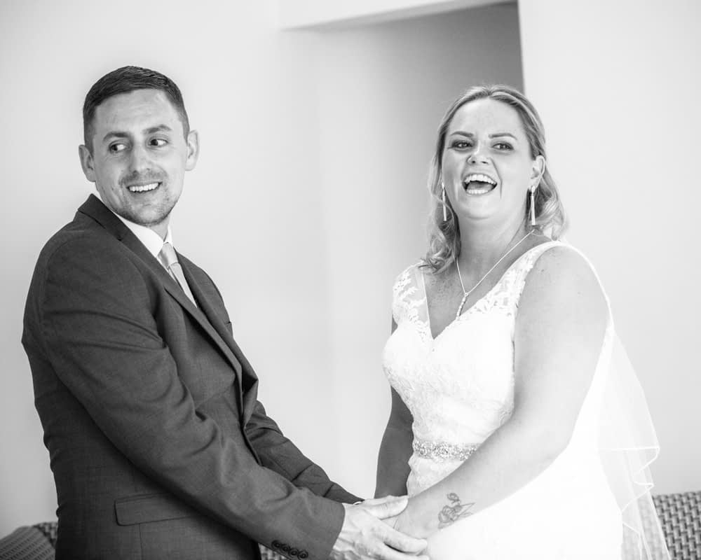 Bride and groom laughing, Lakeside Hotel weddings, Windermere