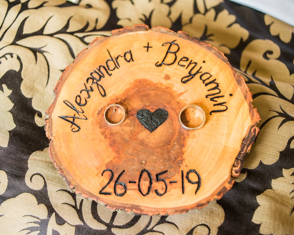 Rings on wood platter, Sheffield weddings