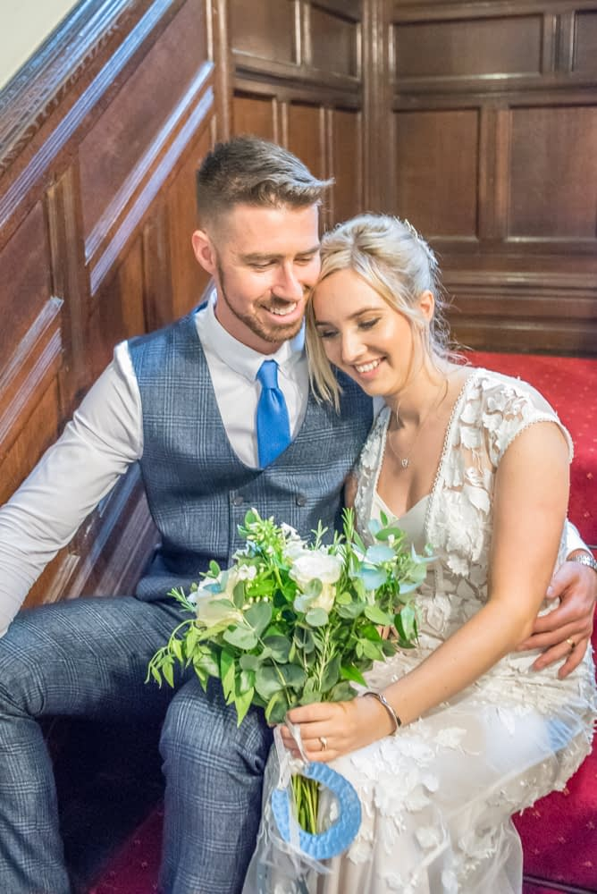 Cuddles on staircase,  wedding photographers Carlisle register office elopement wedding Lake District