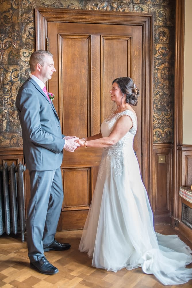 Holding hands in ceremony, Lingholm wedding, Lake District