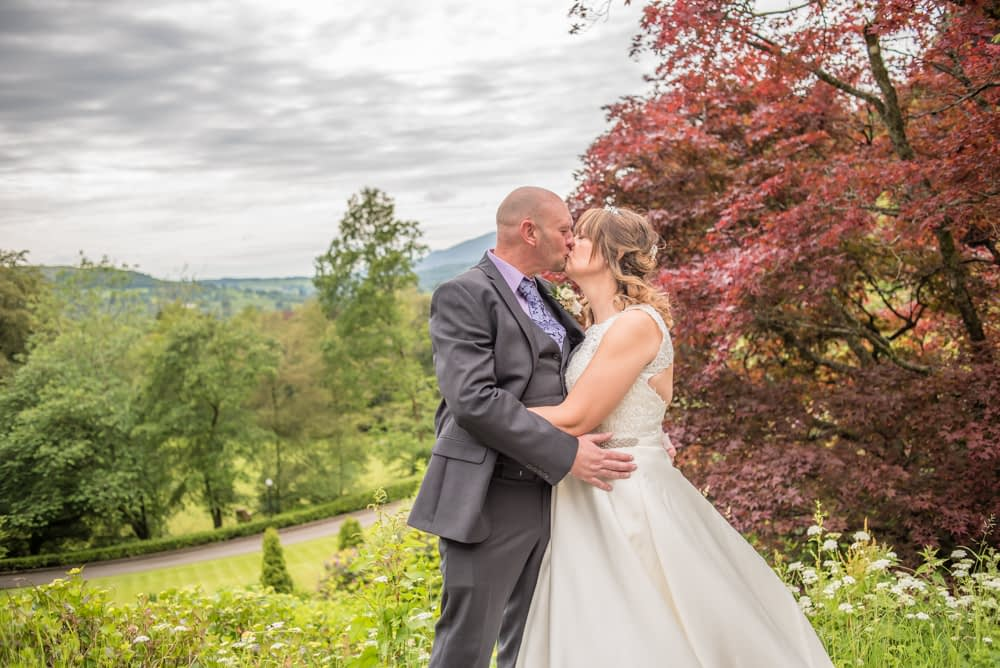 Kisses in the grounds, Merewood Country Hotel Hotel weddings, Lake District